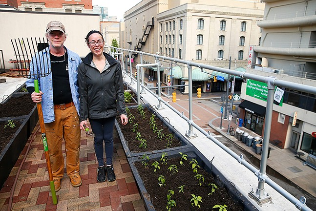 Don Doherty, building superintendent, and Becky Mauro, AM prep cook, tend to the urban garden on the rooftop of Downtown Pittsburgh's Local Fave Gaucho Parrilla Argentina - CP PHOTO: JARED WICKERHAM