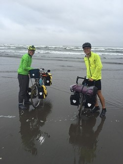 MINDY AHLER (LEFT) AND RYAN HALL PREPARE TO BEGIN THEIR TRIP AUG. 27, IN SEASIDE, ORE.