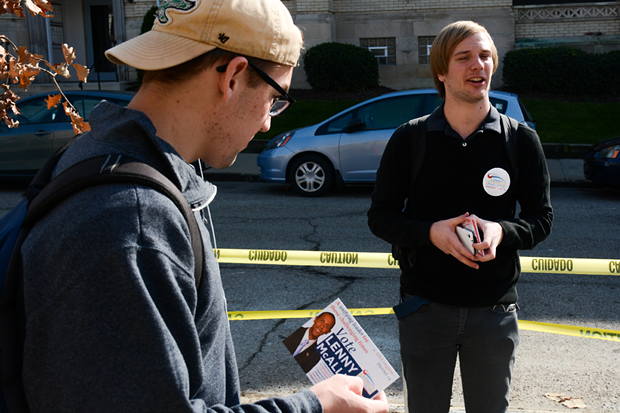 College Republican Arnaud Armstrong hands out flyers for Congressional candidate Lenny McAllister - PHOTO BY STEPHEN CARUSO