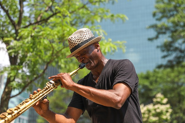 Daryl Leeper plays the saxophone for festival goers outside of Point State Park. - CP PHOTO: KAYCEE ORWIG