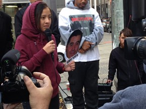 Shayla Esquivel-Hernandez speaking at a rally in support of her father - CP PHOTO BY RYAN DETO