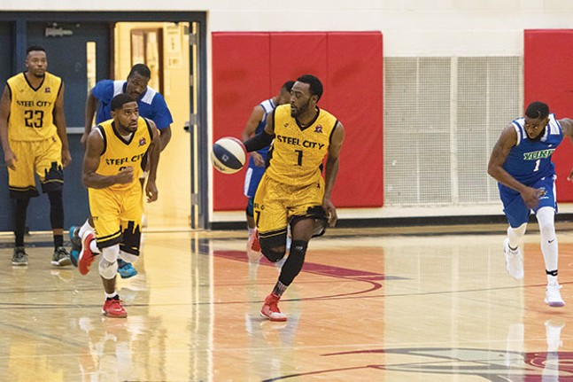 Antonio Reddic, of the Steel City Yellow Jackets, moves the ball down court during the team's win over the York Buccaneers, on Nov. 12. - CP PHOTO BY LUKE THOR TRAVIS