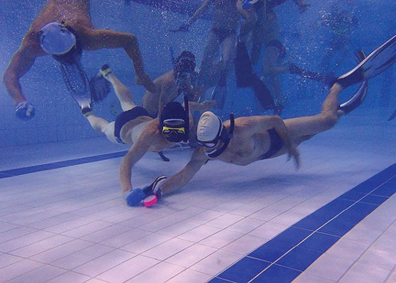 Underwater-hockey players jockey for the puck. - PHOTO COURTESY OF BRITTANY HAUGHTON