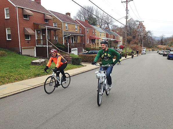 Jeremiah Sullivan (right) rides up a hill during the Dirty Dozen bike race. - CP PHOTO BY RYAN DETO