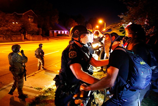 Pittsburgh Police encounter protesters and leaders from the Black community met near Mellon Park in August 2020.