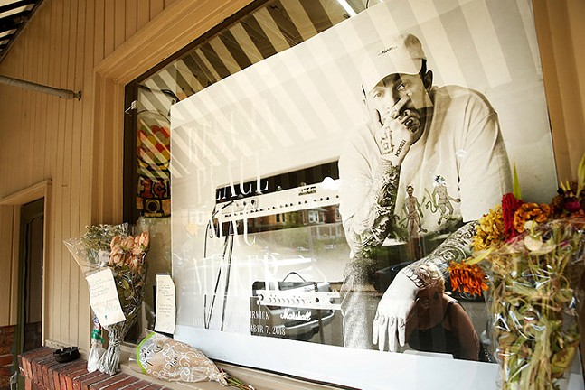 Mac Miller memorial in the window of Frick Park Market, where the late rapper filmed a music video, Sept. 15, 2018 - CP PHOTO: JARED WICKERHAM
