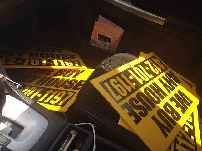 """""""We Buy Any House"""" signs collected by Dave Breingan - PHOTO: COURTESY OF DAVE BREINGAN"""
