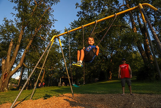 A child swings in Dormont Park before the Dormont Day fireworks. - CP PHOTO: KAYCEE ORWIG