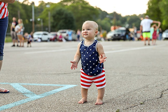 A toddler dances to the music in the Dormont Pool Parking Lot before during the Dormont Day Fourth of July celebration. - CP PHOTO: KAYCEE ORWIG