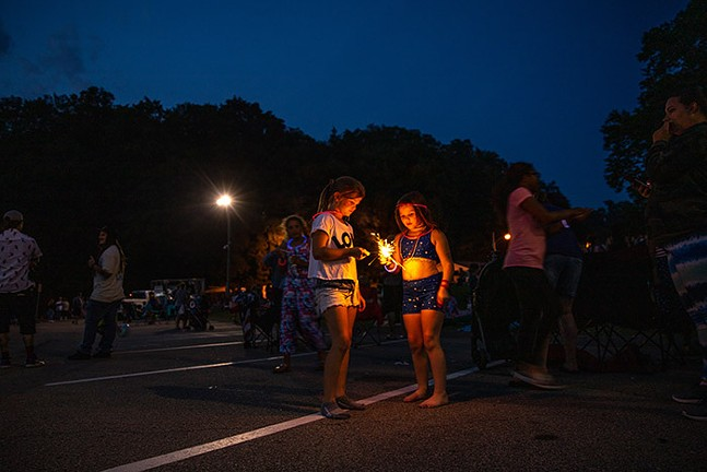 Kids play with sparklers before the Dormont Day fireworks during the Fourth of July Celebration. - CP PHOTO: KAYCEE ORWIG