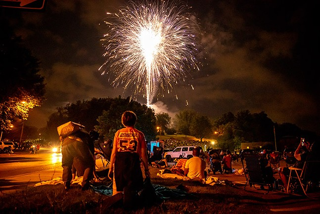 People watch the fireworks from outside the Dormont Swimming Pool on July 4, 2021. - CP PHOTO: KAYCEE ORWIG