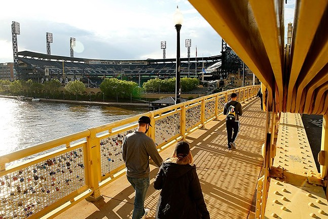 Pittsburgh Pirates fans walk across the Roberto Clemente Bridge on way to PNC Park - CP PHOTO: JARED WICKERHAM