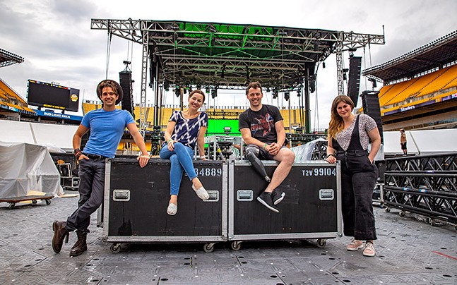 The stars of Pittsburgh CLO's The Wizard of Oz in front of the stage at Heinz Field: Dan Deluca (Scarecrow), Jessica Grove (Dorothy), Evan Ruggiero (Tin Man), and Drew Leigh Williams (Lion) - CP PHOTO: KAYCEE ORWIG