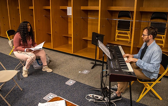 Melessie Clark (Glinda) practices with music director James Cunningham inside Heinz Field for Pittsburgh CLO's The Wizard of Oz. - CP PHOTO: KAYCEE ORWIG