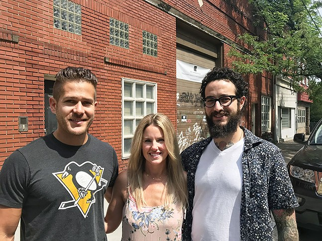 Brett Minarik, Phoebe Fraser, and Adam Harvey, owners of the proposed Lawrence Hall - CP PHOTO: RYAN DETO