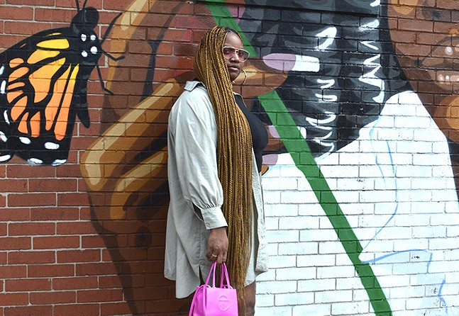 Mia Marshall in front of Pittsburgh artist Wavy Wednesday's mural in Wilkinsburg - CP PHOTO: TERENEH IDIA