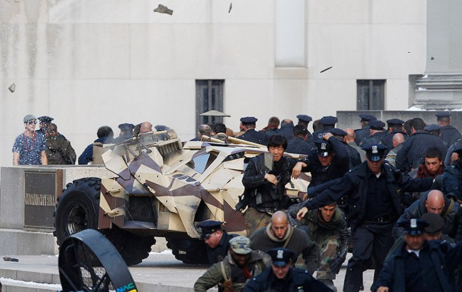 Hundreds of extras act out a scene when the Batmobile drove up the steps of the Institute with shrapnel flying in the air from an explosion during the filming of Dark Knight Rises on July 31, 2011. - CP PHOTO: JARED WICKERHAM
