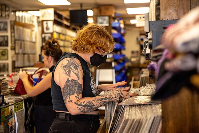 A customer browses through the selection at Attic Record Store in Millvale. - CP PHOTO: KAYCEE ORWIG