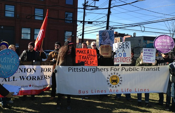 Uber protesters in Denny Park, in Pittsburgh's Strip District - CP PHOTO BY RYAN DETO