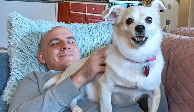 Amanda Waltz's husband with Villanelle, their rescue dog - CP PHOTO: AMANDA WALTZ