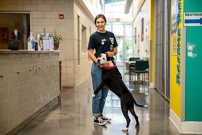 Humane Animal Rescue customer care associate Michaela Yonto with rescue dog Cinderella - CP PHOTO: KAYCEE ORWIG