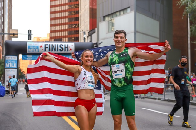 The winners of the pro-women's and pro-men's races, Sinclaire Johnson and Vincent Ciattei, pose together at the Fleet Feet Liberty Mile. - CP PHOTO: KAYCEE ORWIG