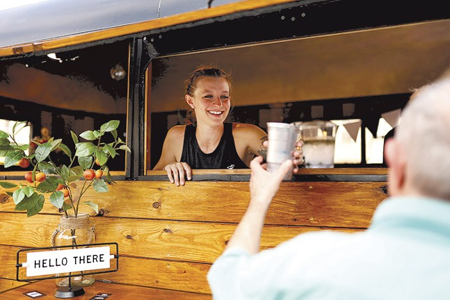 Co-owner Katie Sirianni serves a customer during the grand opening of Sips Mobile Bar in Dormont on Fri., July 23. - CP PHOTO: JARED WICKERHAM