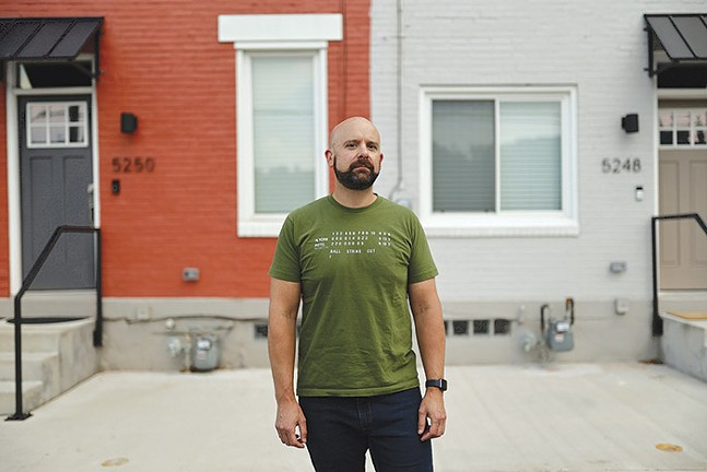 Justin Rossini near his home and the proposed Amazon warehouse in Lawrenceville - CP PHOTO: JARED WICKERHAM
