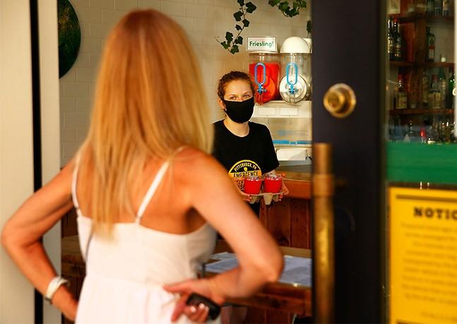 Customer entering a Pittsburgh restaurant in 2020 - CP PHOTO: JARED WICKERHAM