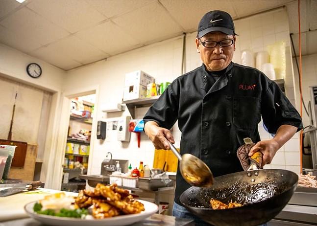 Michael Chou prepares the pork with kyoto sauce. - CP PHOTO: KAYCEE ORWIG