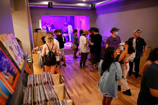 Customers walk around the Government Center record store on East Street in Pittsburgh's North Side before an evening of shows on Fri., Aug. 13. - CP PHOTO: JARED WICKERHAM