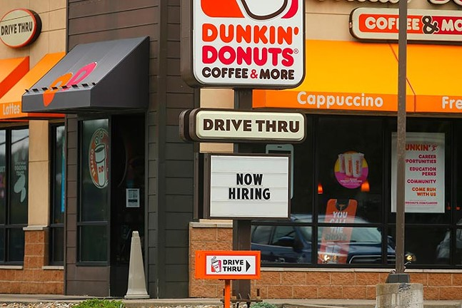 """A """"Now Hiring"""" sign is shown at Dunkin' Donuts along Route 51 on Thu., Aug. 12. - CP PHOTO: JARED WICKERHAM"""