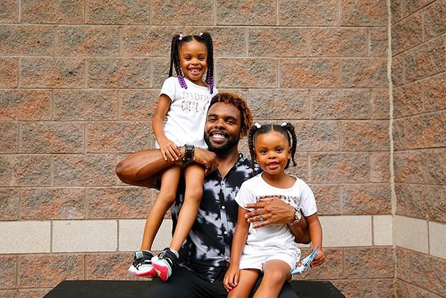 Terry Jones and his daughters - CP PHOTO: JARED WICKERHAM