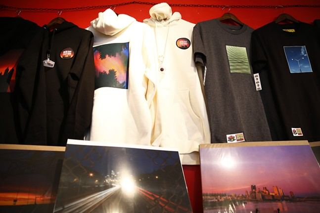 """Prints, sweatshirts, and T-shirts are shown on sale at """"Proper Nouns', a photography show by Justin Boyd, at Bankrupt Bodega. - CP PHOTO: JARED WICKERHAM"""