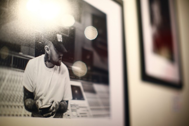 A print of the late Mac Miller hangs at Proper Nouns, a photography show by Justin Boyd, at Bankrupt Bodega in Bloomfield on Fri., Sept. 3, 2021. - CP PHOTO: JARED WICKERHAM