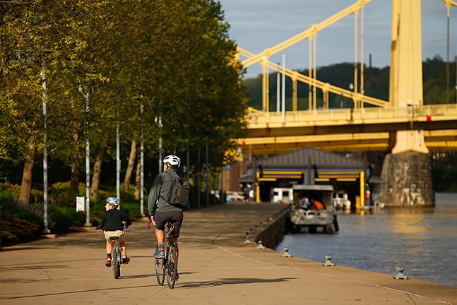 Cyclists riding on the Three Rivers Heritage Trail on Pittsburgh's North Side. - CP PHOTO: JARED WICKERHAM
