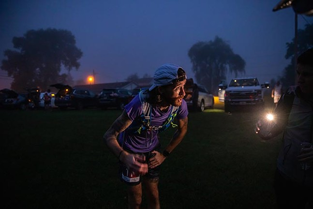 Greg Brunner prepares himself before the 6:30 a.m. start time on race day. - CP PHOTO: KAYCEE ORWIG