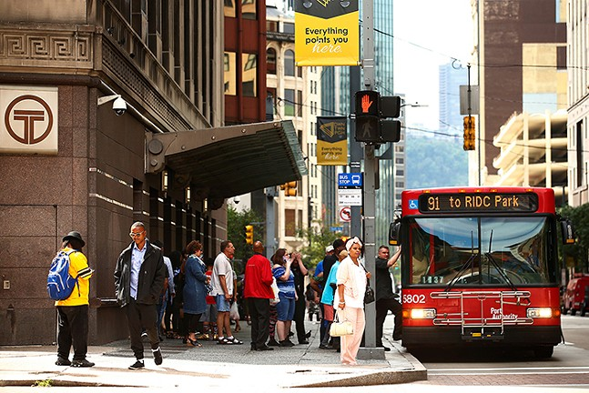Bus stop in Downtown Pittsburgh - CP PHOTO: JARED WICKERHAM
