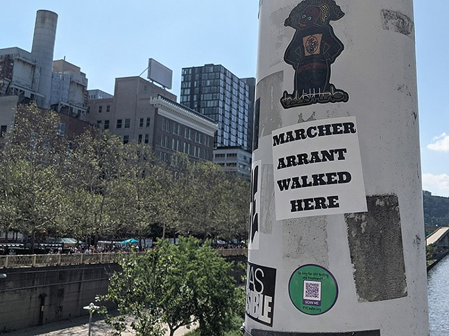 One of Marcher Arrant's stickers above the Allegheny River - CP PHOTO: LISA CUNNINGHAM
