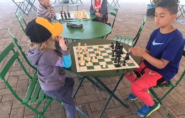 Young players with Queens Gambit - PHOTO: COURTESY OF QUEENS GAMBIT