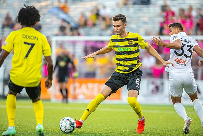 Pittsburgh Riverhounds winger Alex Dixon (left) scored late in an Oct. 10 match, thanks to an overhead kick assist by Tommy Williamson (center). - PHOTO: COURTESY OF PITTSBURGH RIVERHOUNDS