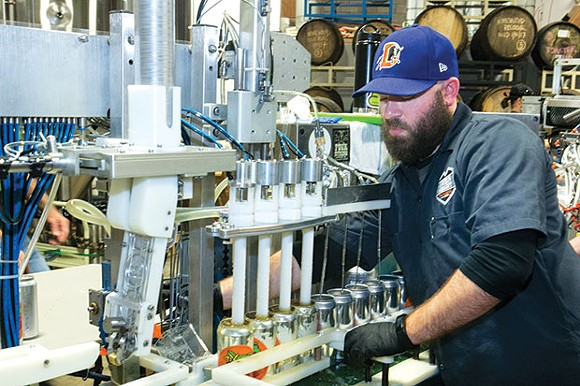 Jon Ebner, of Iron Heart Canning Co., cansBigger Hop. - CP PHOTO BY JOHN COLOMBO