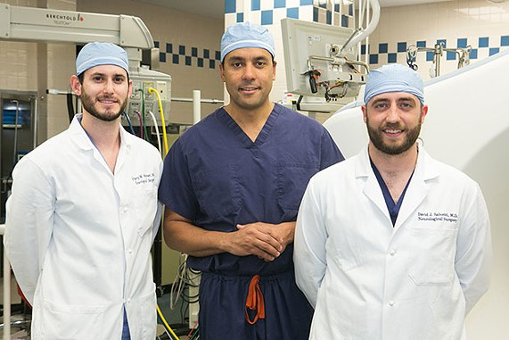 UPMC neurosurgeon David Okonkwo, center, with his current residents Gregory Weiner (left) and David Salvetti - CP PHOTO BY JOHN COLOMBO