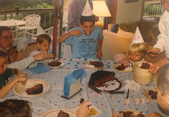 The author at around age 3, eating birthday cake with her cousins - PHOTO COURTESY OF SUELLEN ROBERTS