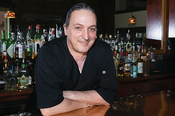 Chef/co-owner Michele Savoia leans on Dish's copper-topped bar. - CP PHOTO BY JOHN COLOMBO