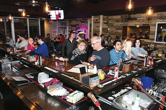 Behind the bar at happy hour at The Yard in Shadyside - CP PHOTO BY JOHN COLOMBO