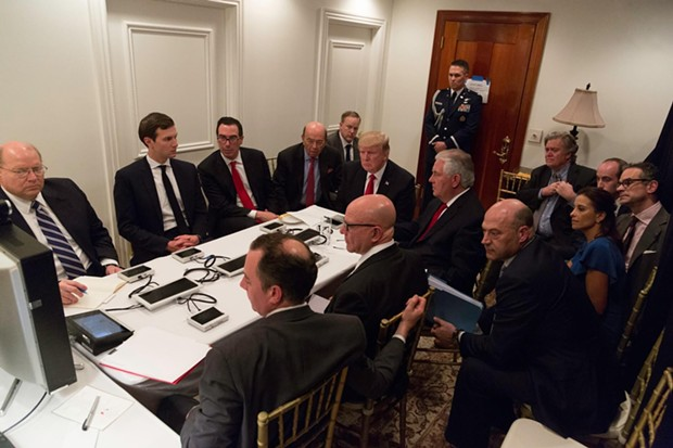 President Donald Trump receives a briefing on a military strike on Syria from his National Security team on April 6. - WHITE HOUSE PHOTO