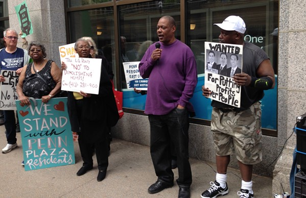 Affordable-housing advocates rally on Smithfield Street in Downtown, Pittsburgh. - CP PHOTO BY RYAN DETO