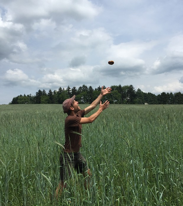 Justin Lubecki catching a bagel in the high grass - PHOTO COURTESY OF ANNE DEFAZIO