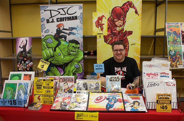 DJ Coffman, a Pittsburgh-area comics artist and occasional City Paper contributor,  mans his booth at 3 Rivers Comicon on Sun., May 21. - CP PHOTOS BY KRISTA JOHNSON